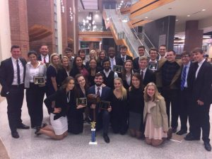 Mock trial team posing with trophy