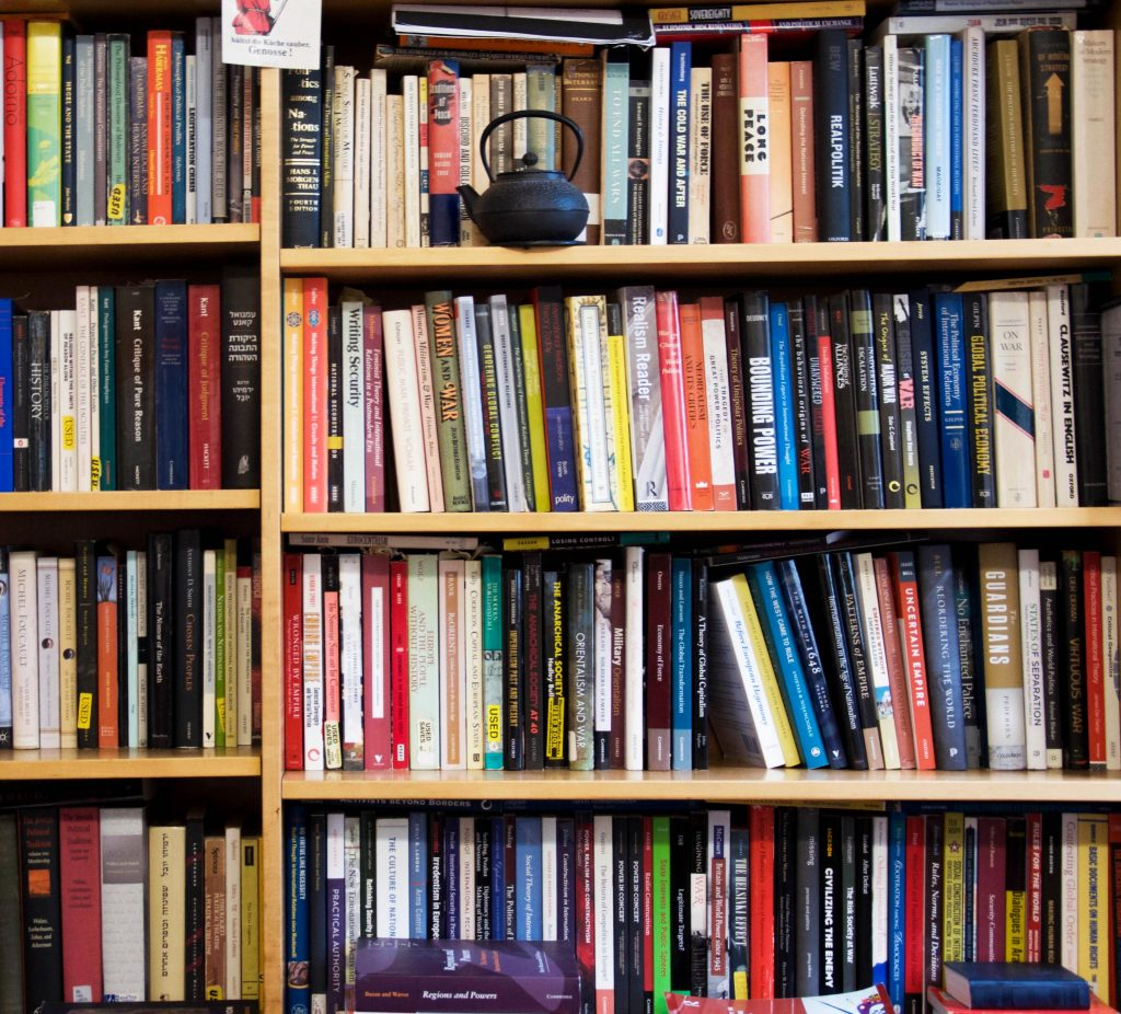 a bookcase filled with assorted hard- and soft-cover volumes