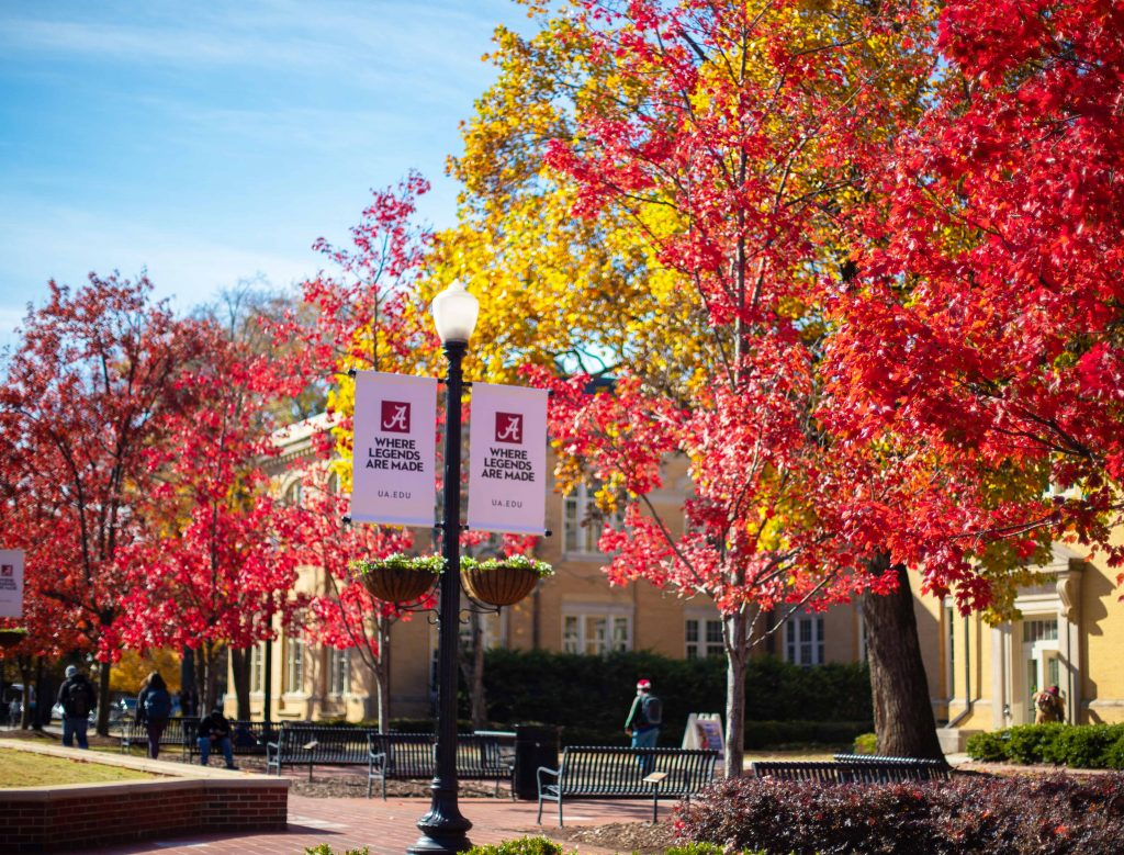 colorful fall foliage on campus, next to a banner reading where legends are made