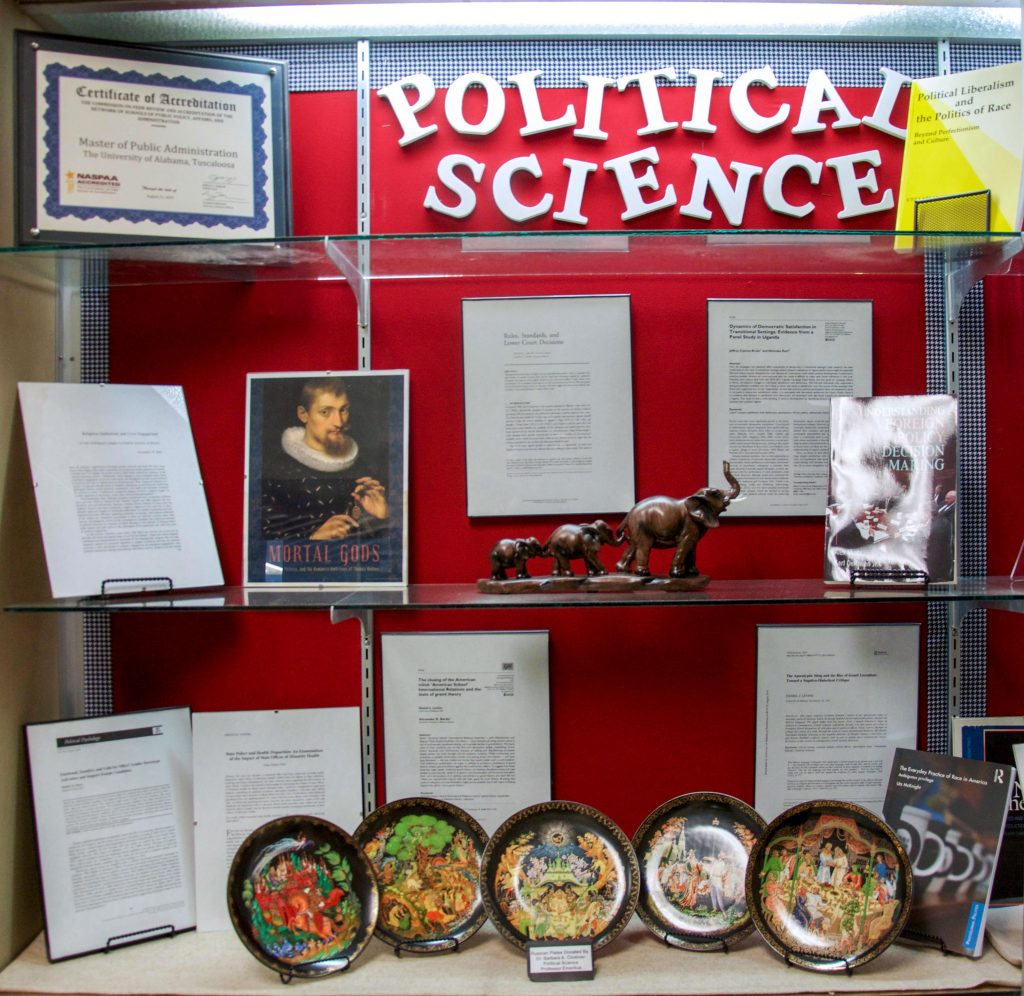 a display case filled with items donated by faculty of the department of political science